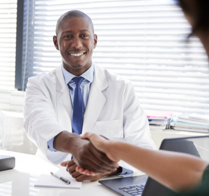 doctor smiling while shaking hands