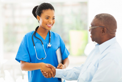 senior man shaking hands with a nurse