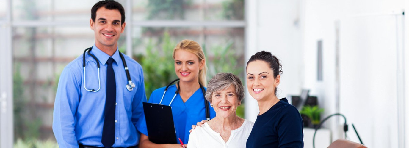 senior woman with her caregiver in doctors appointment